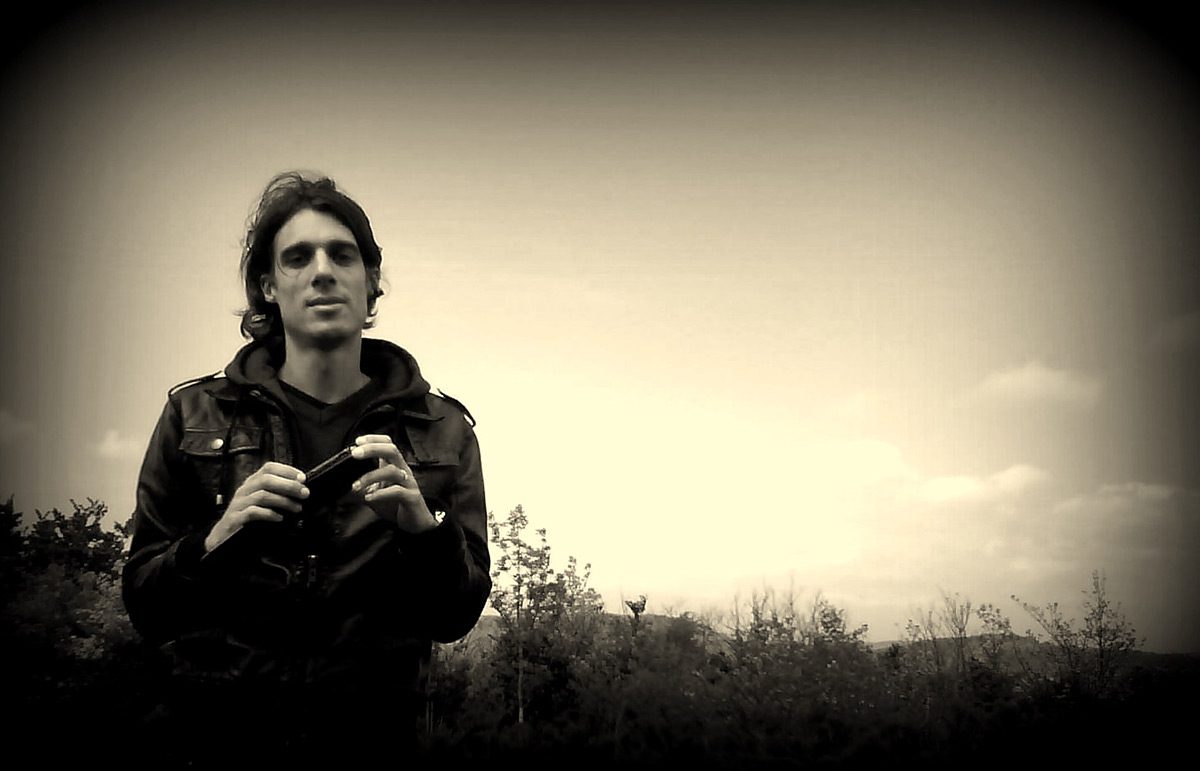 Photo of Psychedelic Indie Rock Music Artist Samuel Christen, half body photo with background nature