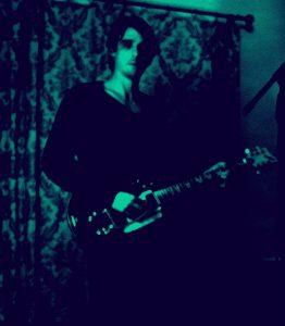 Photo of Psychedelic Indie Rock Music Artist Samuel Christen, half body photo in his home studio