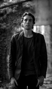 Photo of Psychedelic Indie Rock Music Artist Samuel Christen, full body photo background ruins